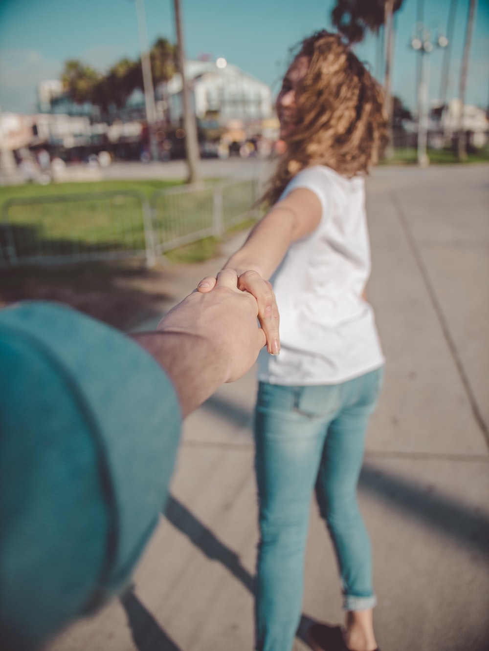 woman holding hands with person during daytime