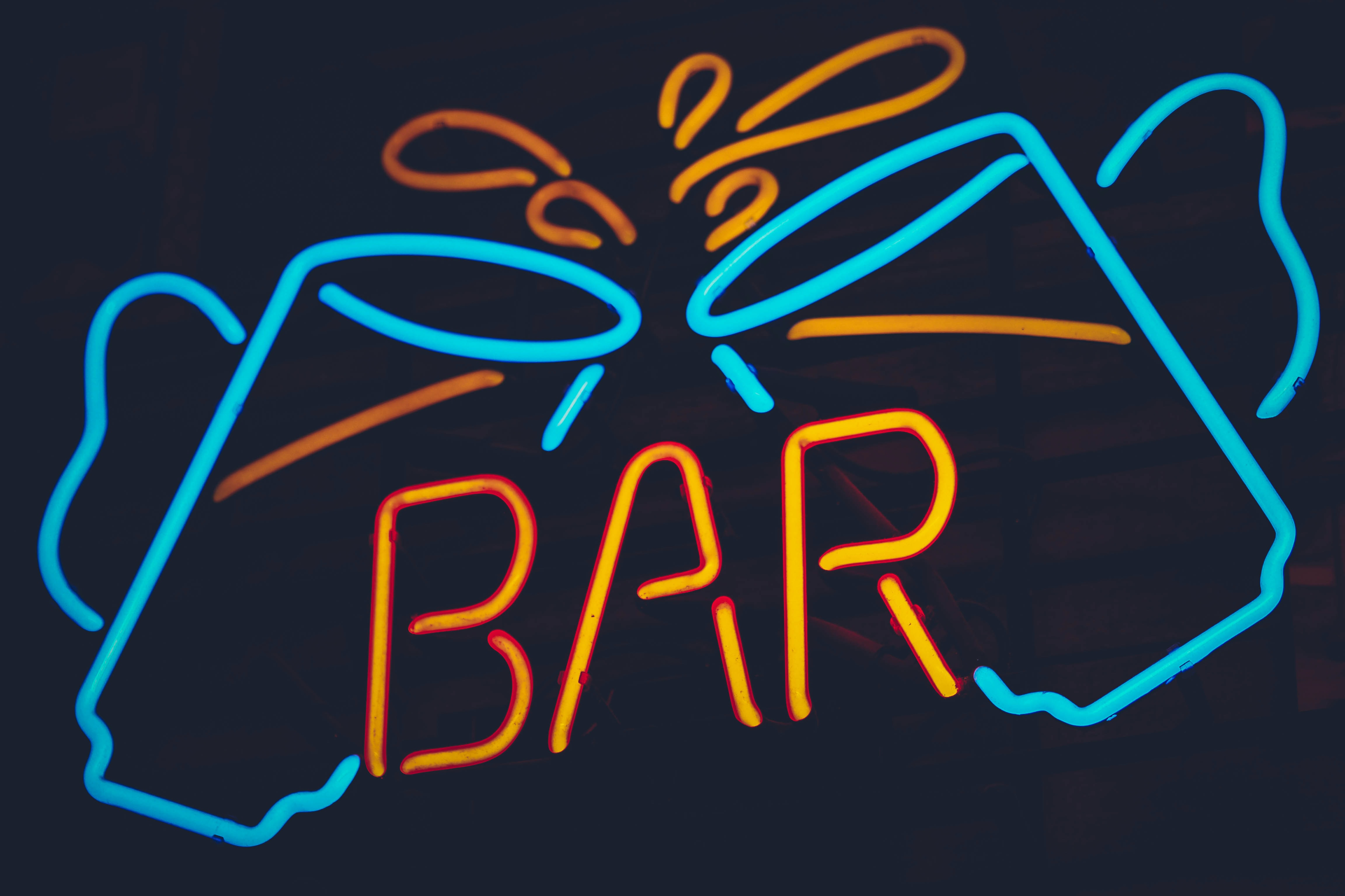 teal and orange bar neon sign