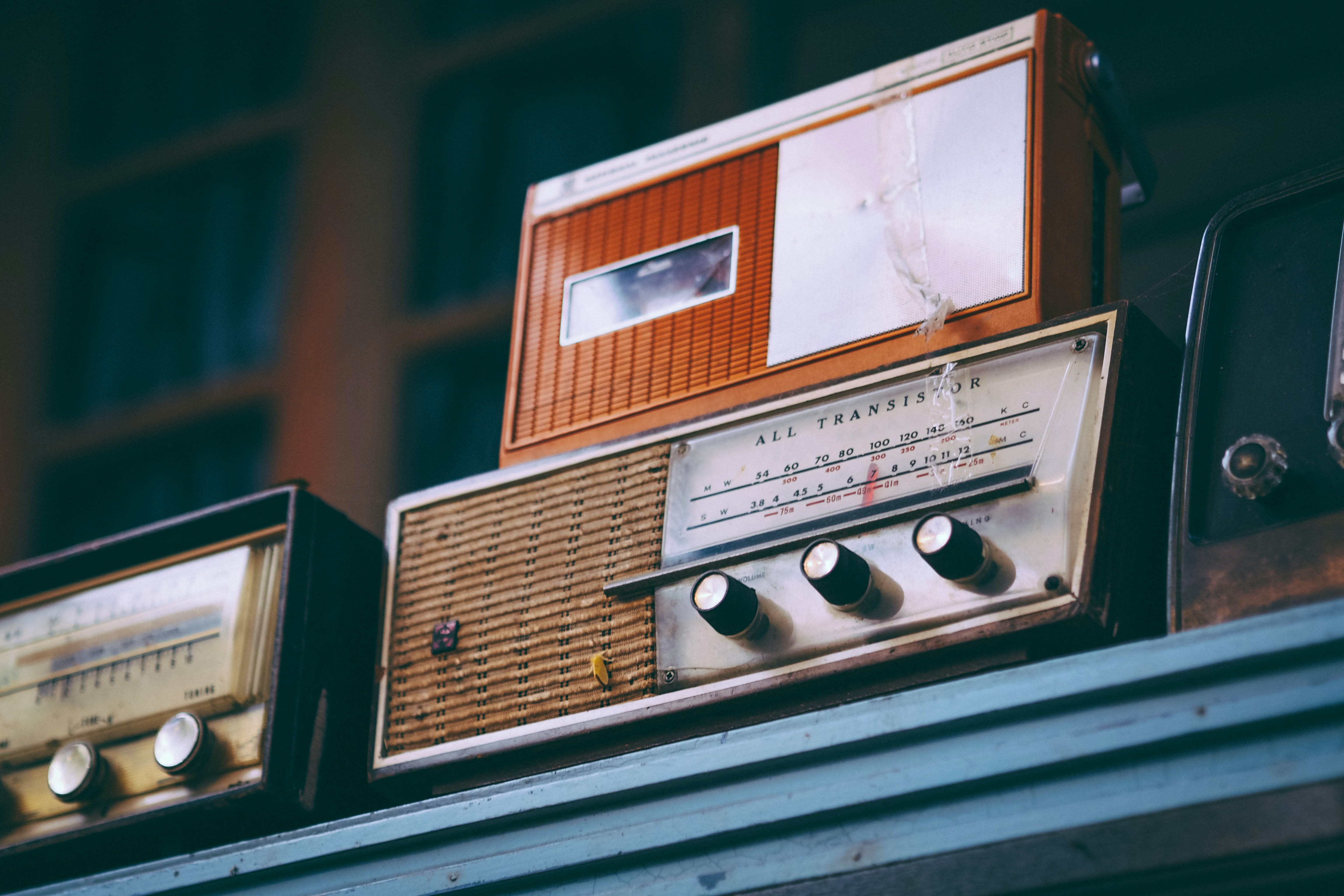 gray and brown transistor radio on table