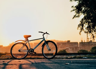 silhouette of white bicycle during sunrise