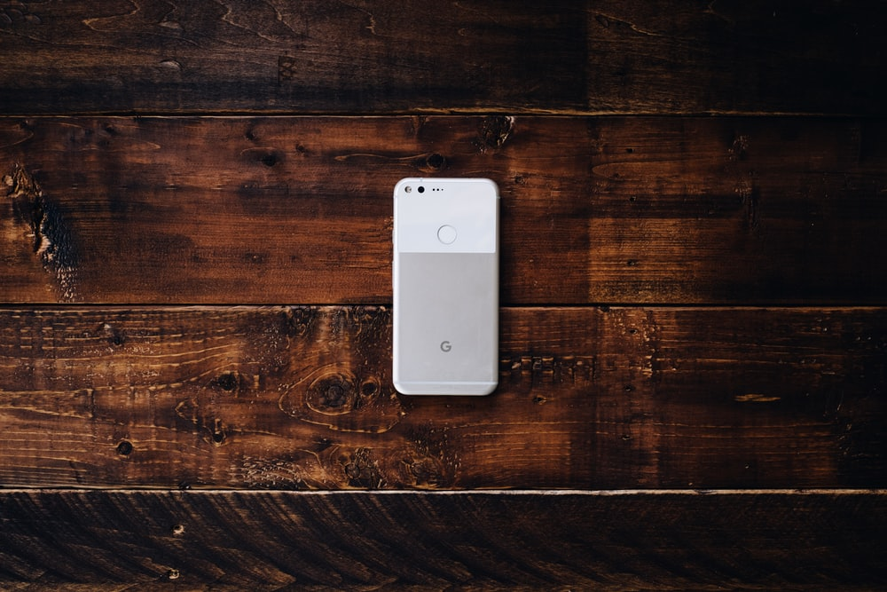 flat lay photography of white Google Pixel Android smartphone
