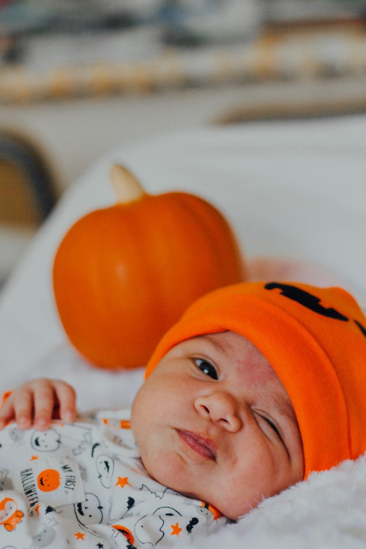 baby wearing orange knit cap