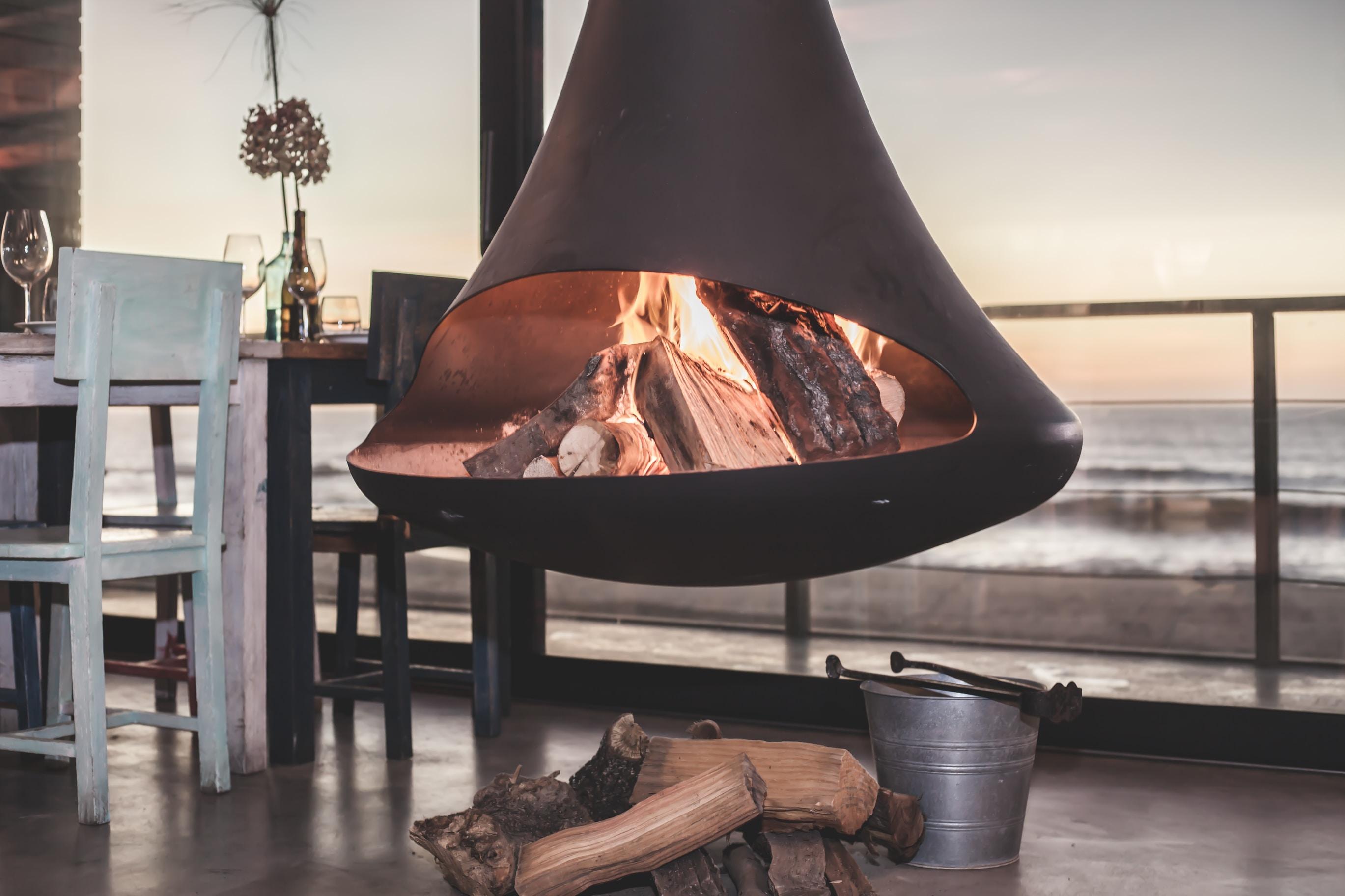 black firepit near dining set inside room