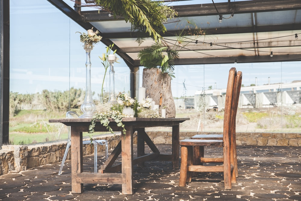 green leafed plants on brown wooden table