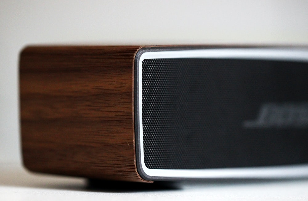 selective focus photography of black Bose speaker