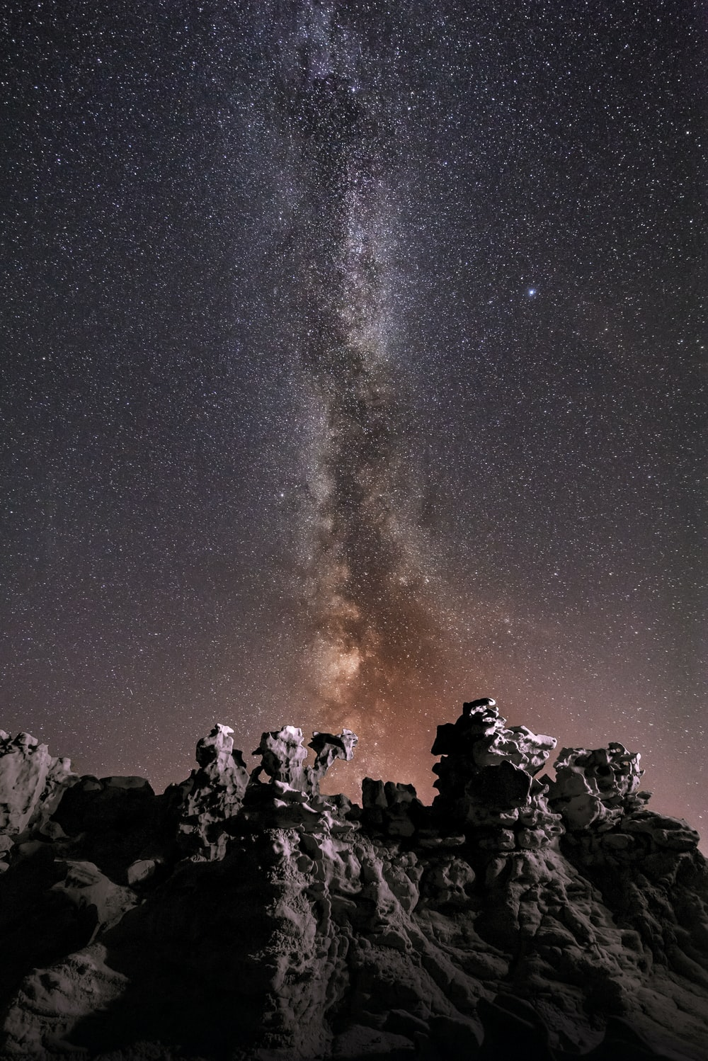 silhouette photography of rock formation