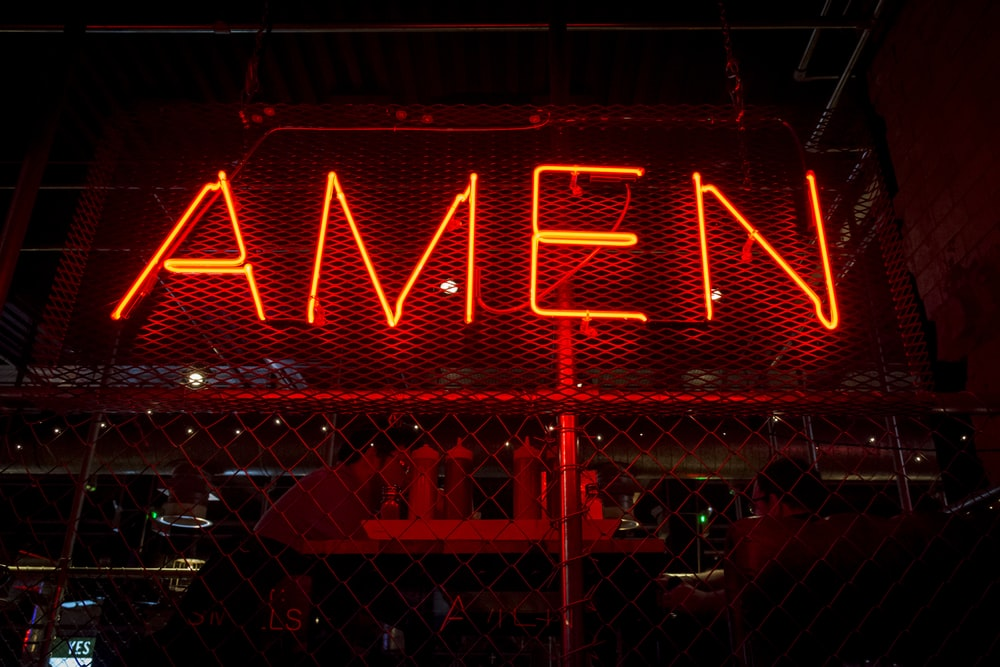red Amen lit-up signage