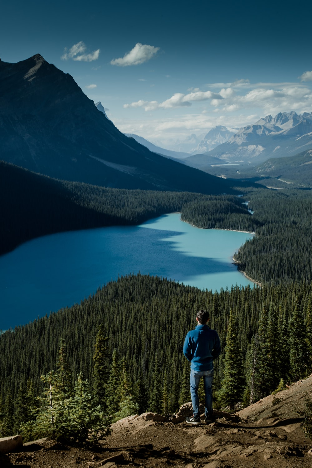 person watching view of lake from mountain