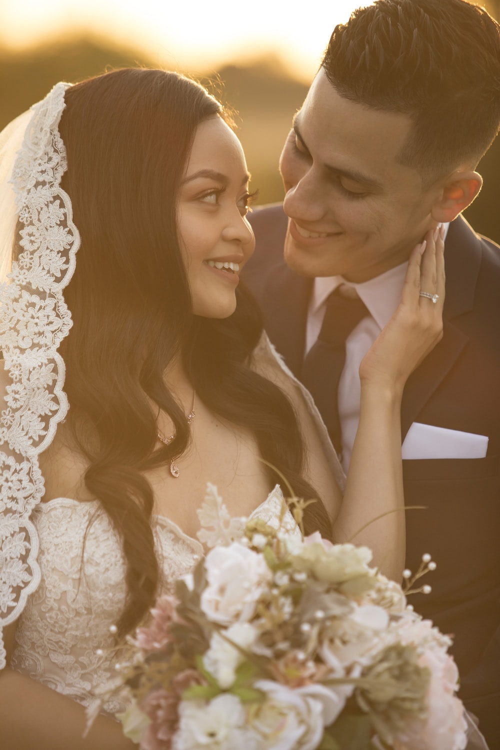 bride and groom smiling each other photo