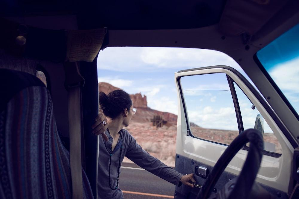 man opening vehicle door