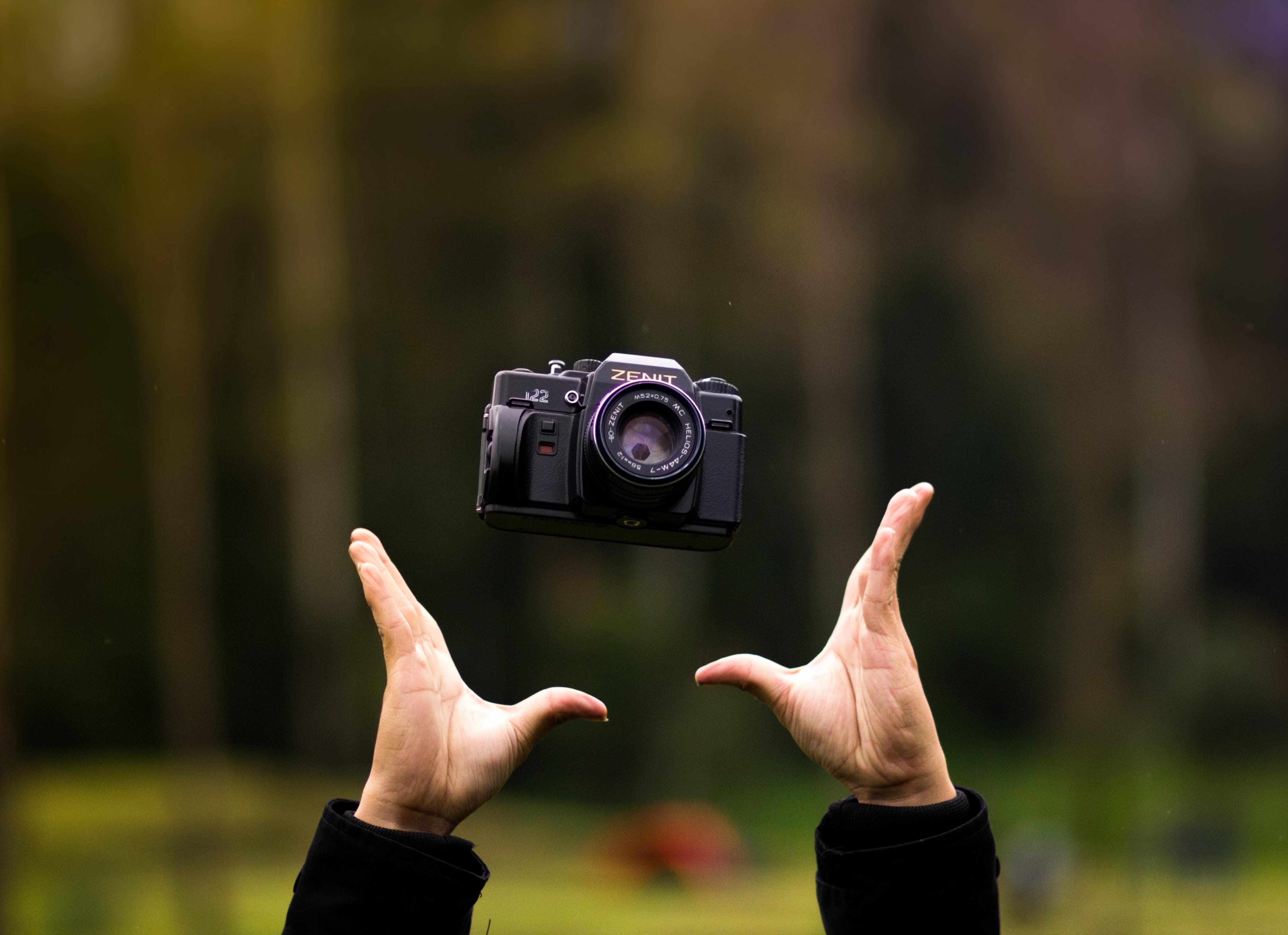selective focus photography of person trowing black bridge camera