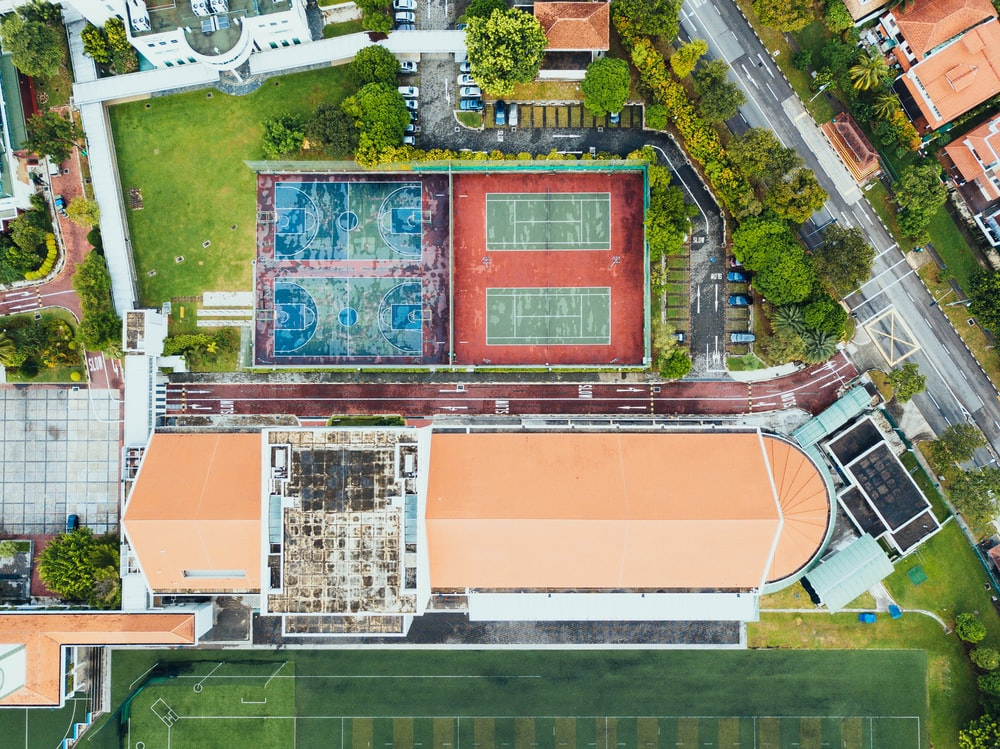 aerial photography of stadium and courts