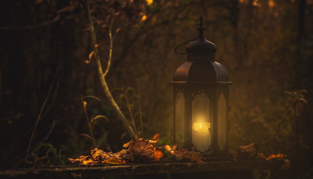 yellow pillar candle in black lantern