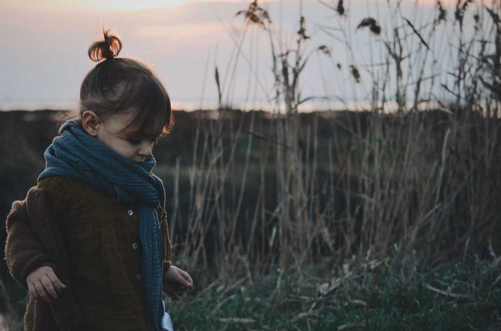 girl in brown coat