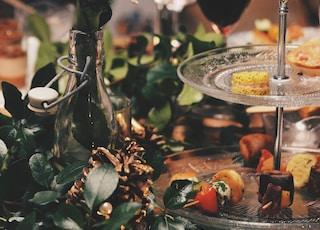 clear glass 2-tier plate beside flower arrangement