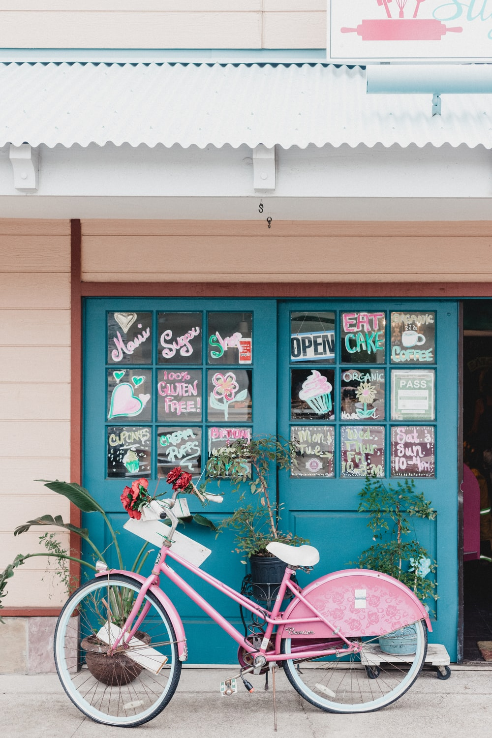 pink bicycle near house
