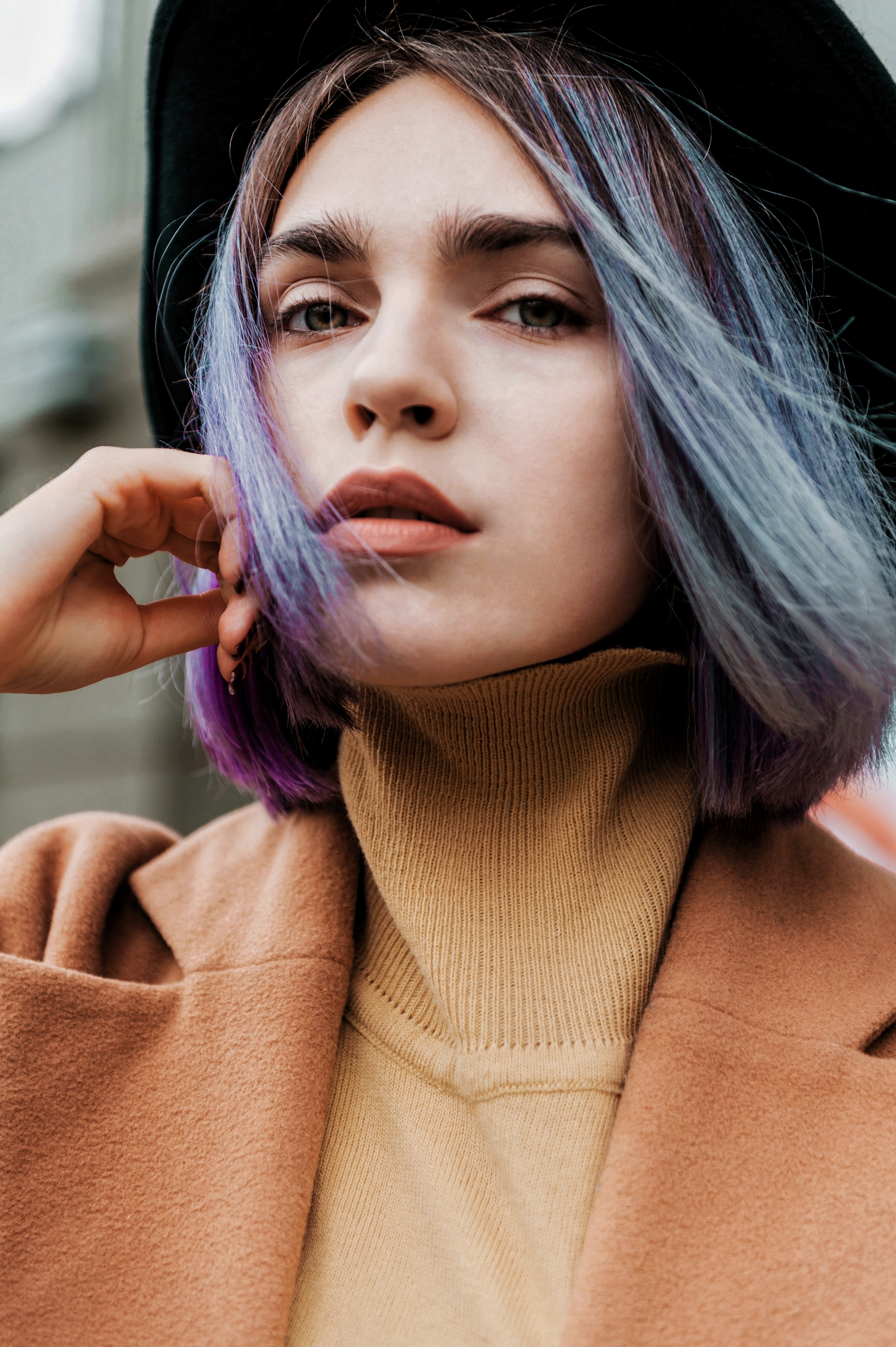 woman with blue and purple ombre hair dye