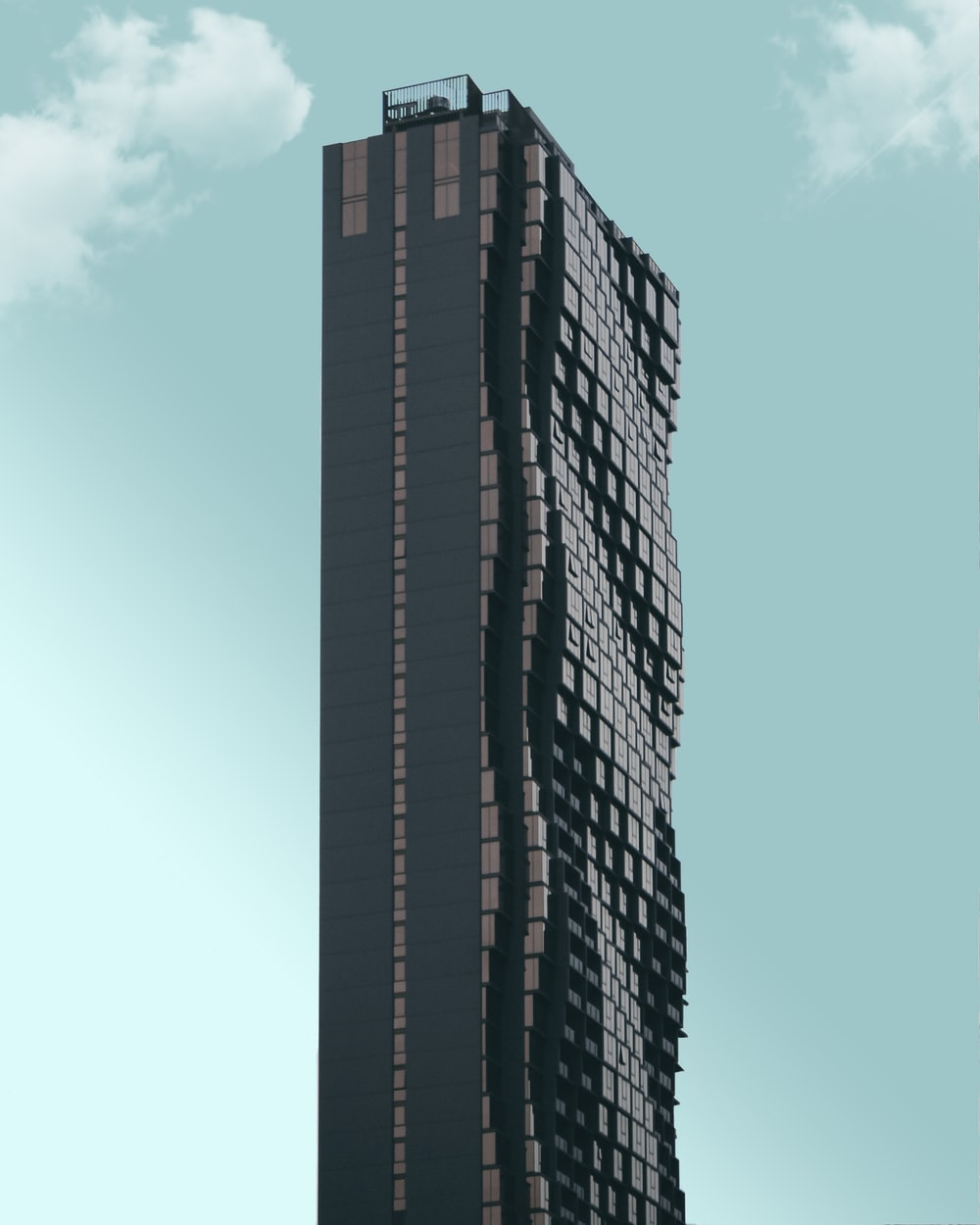 black high-rise building during daytime