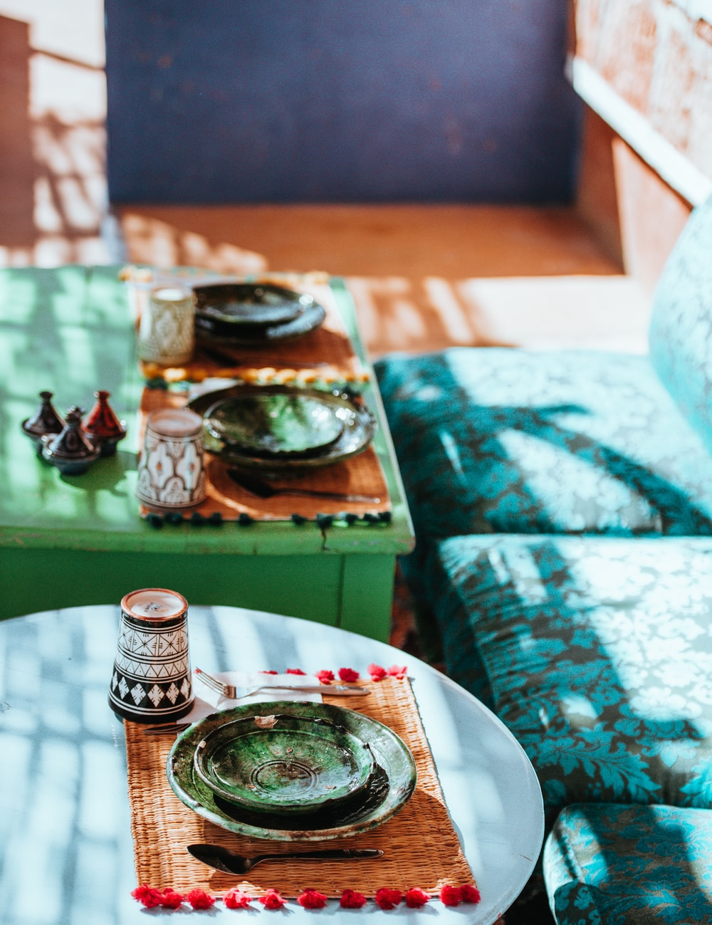 green ceramic bowl and plate on table