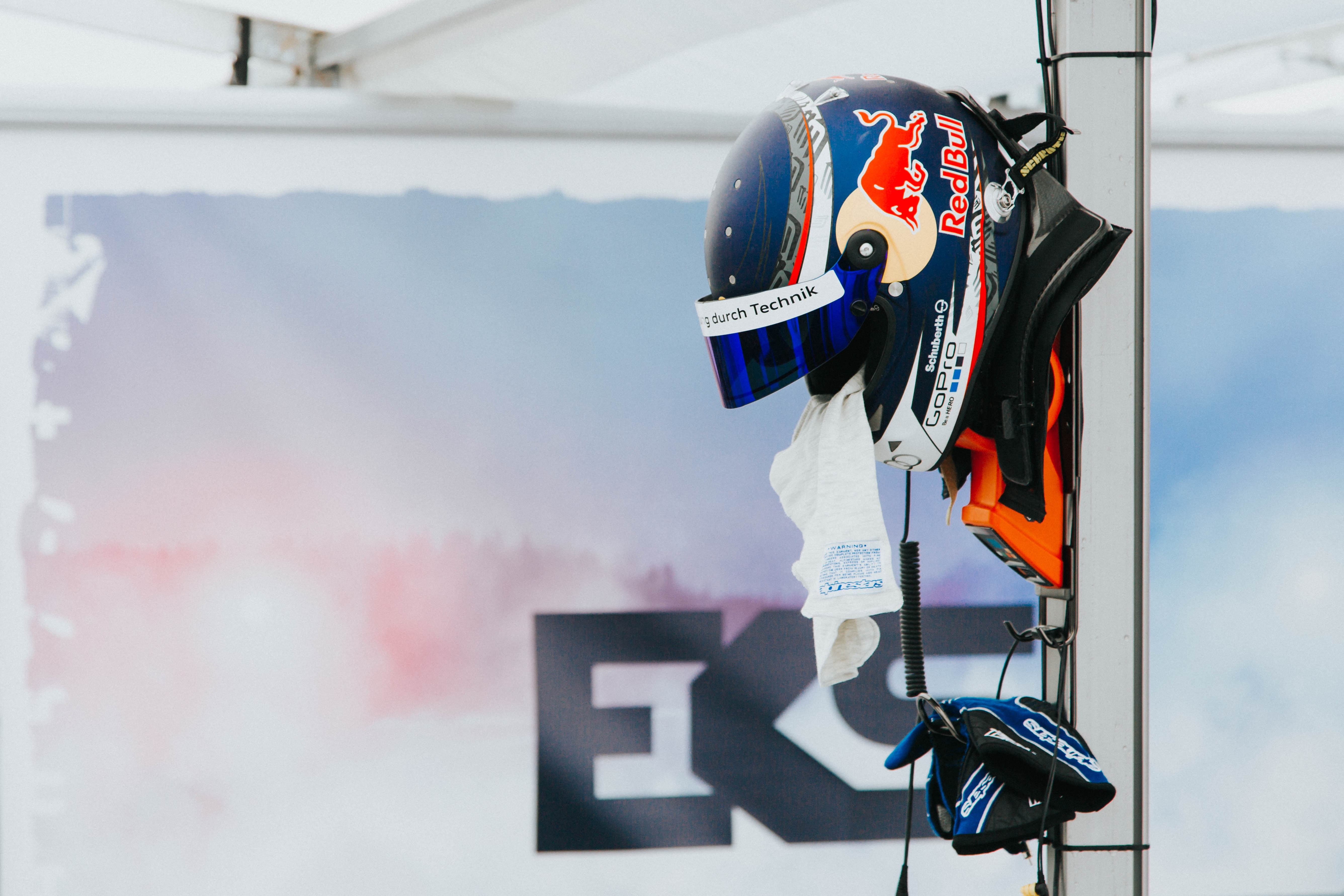 blue and white Redbull full-face helmet