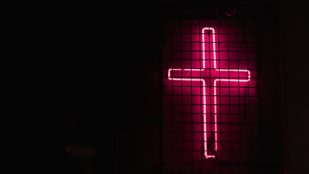 pink cross neon signage