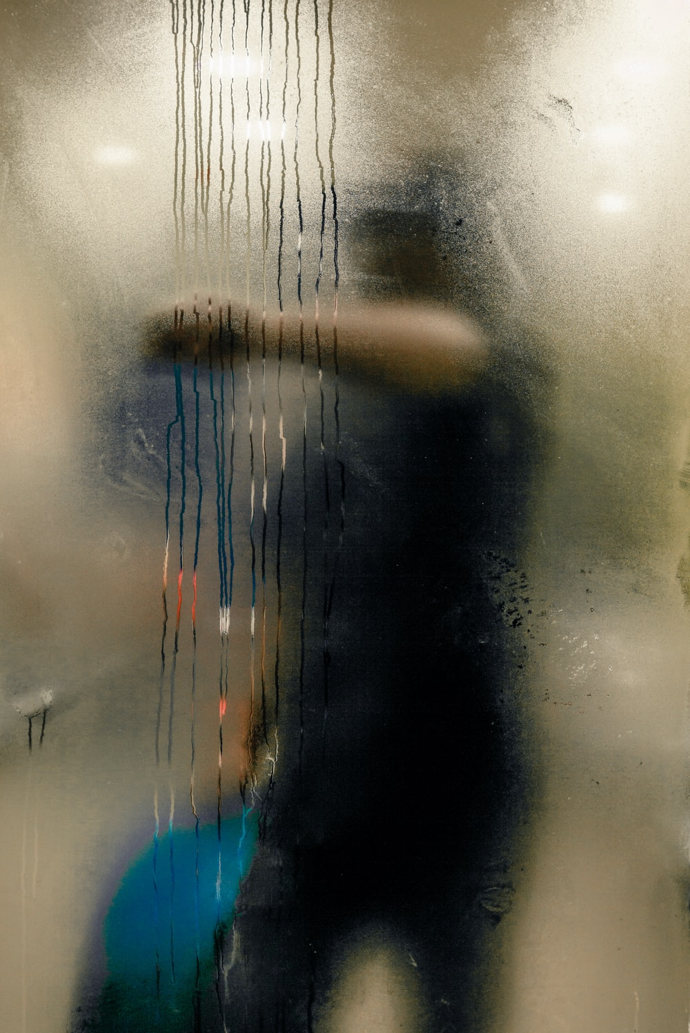 man swiping glass panel