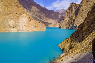 body of water in between canyons pakistan teams background