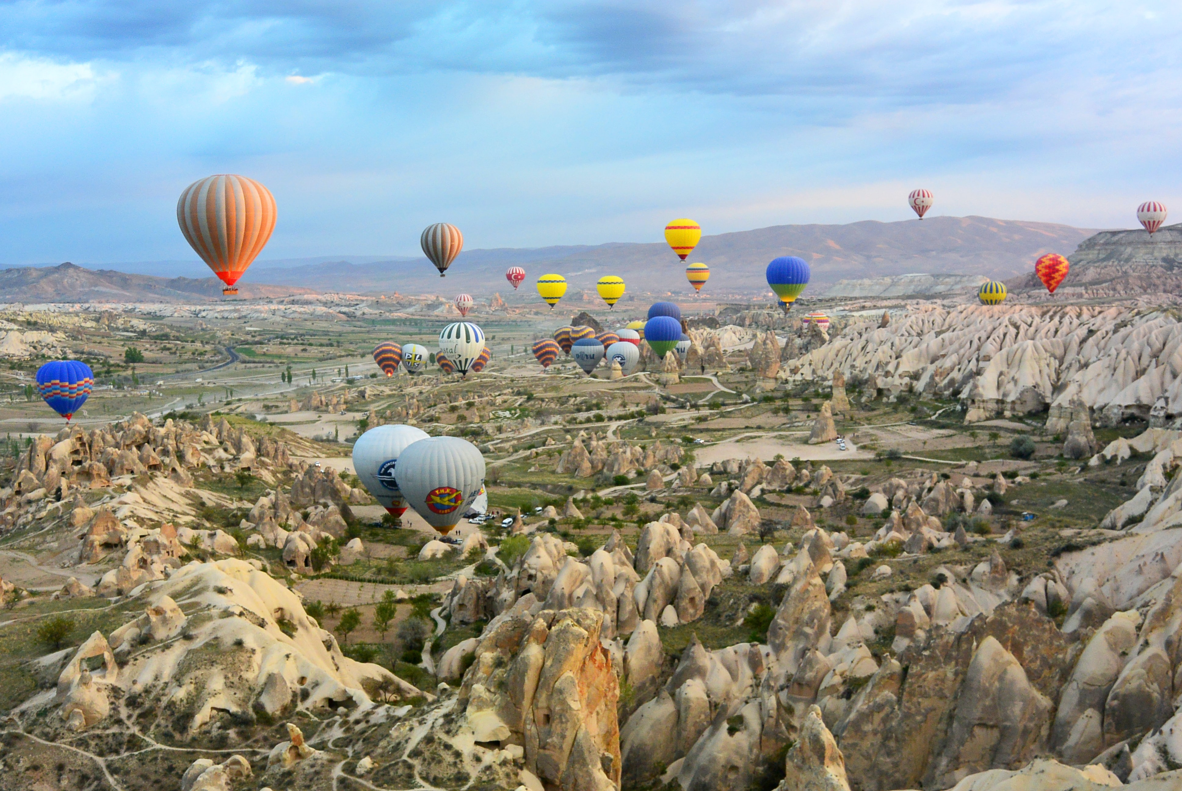 photo of assorted-color air balloon lot in mid air during daytime