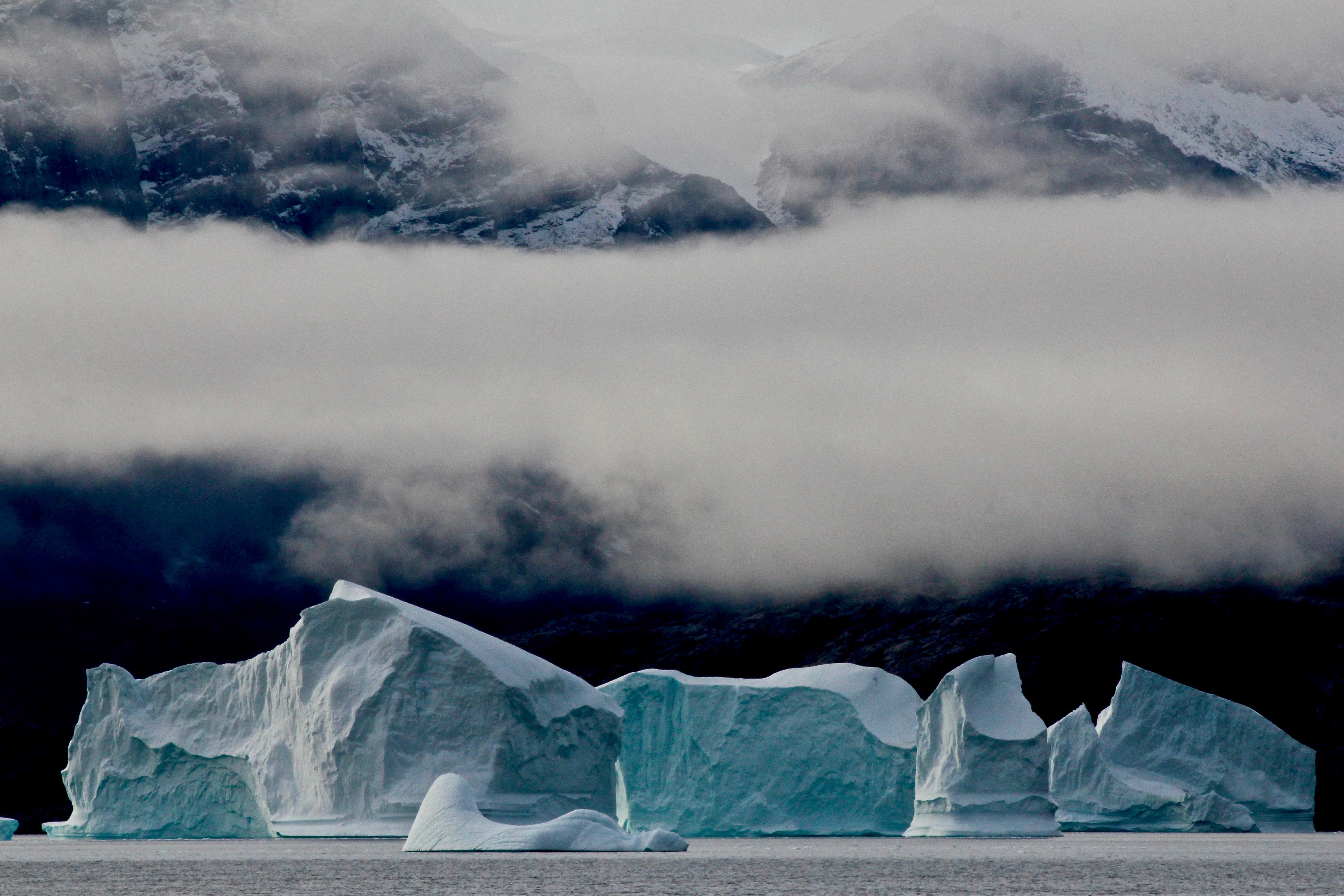 ice burn under grace cloud surrounded by body of water