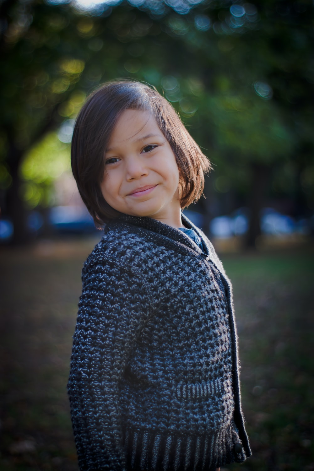 selective focus photo of toddler in black cardigan