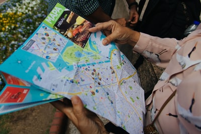 person holding map close-up photo