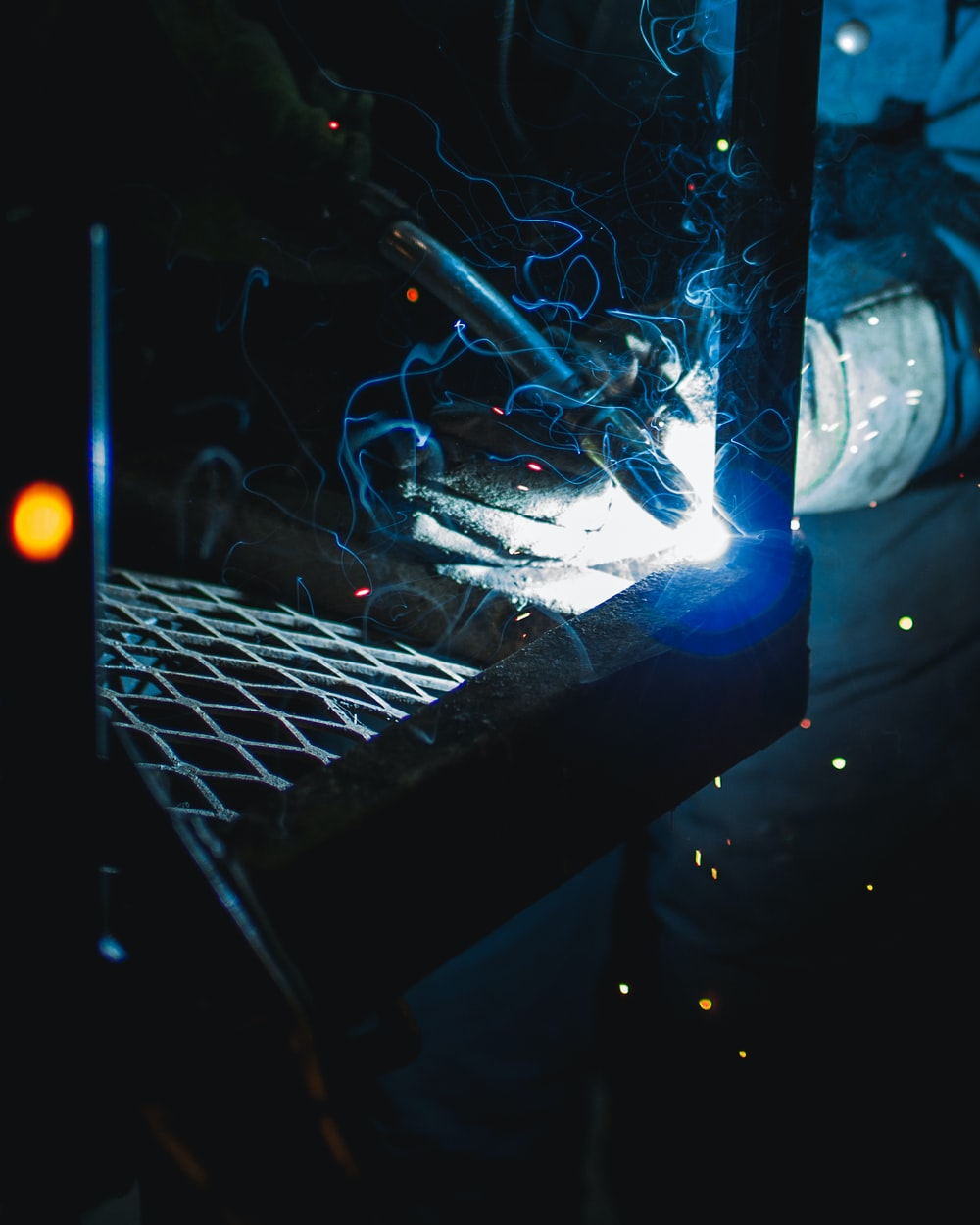 person holding a welding equipment
