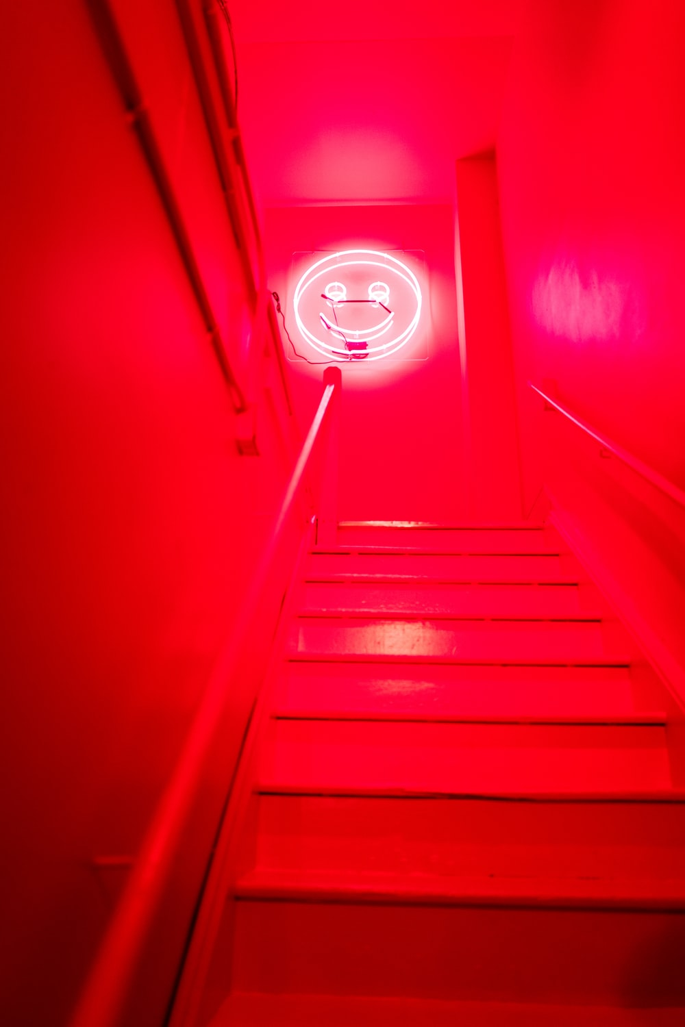 red and white staircase with white light