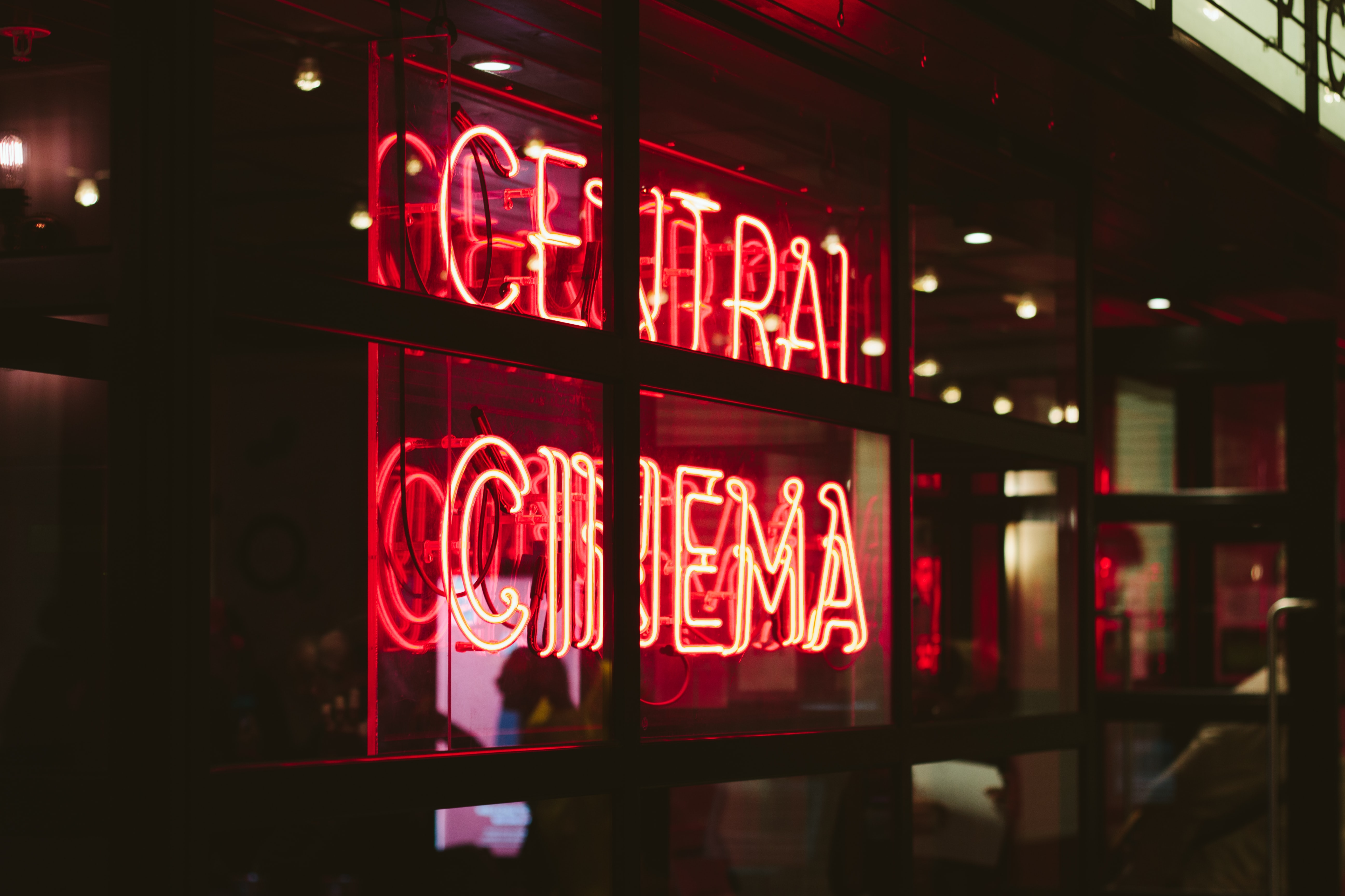 turned on central cinema neon sign on wall