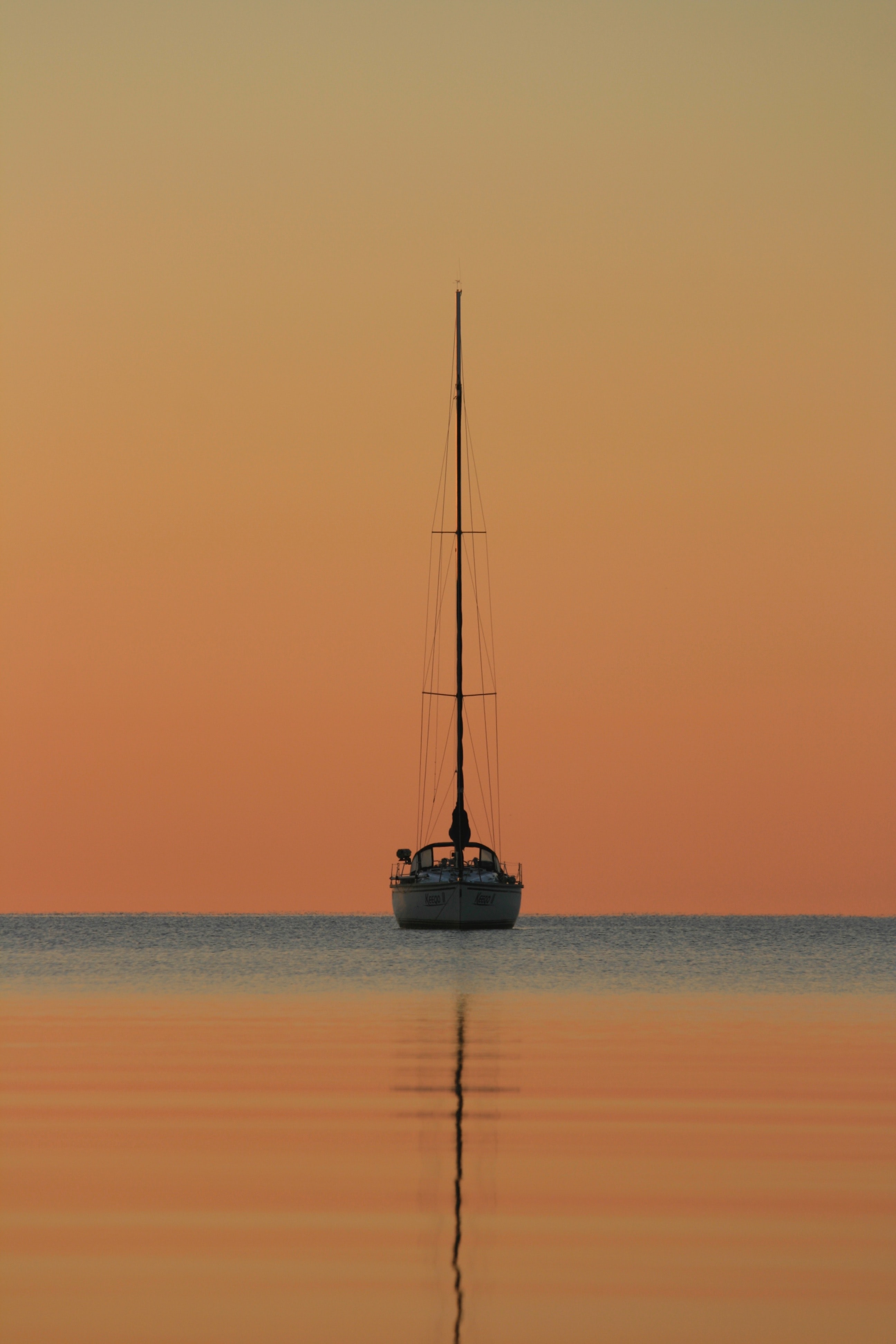 white and black boat on body of water during golden hour