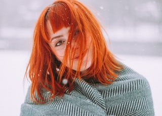 selective focus photography of woman during snow