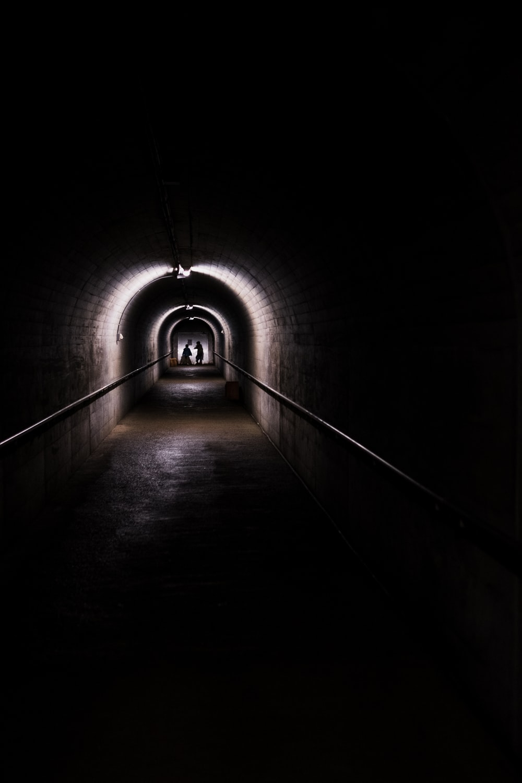 dome gray concrete dim-lighted tunnel