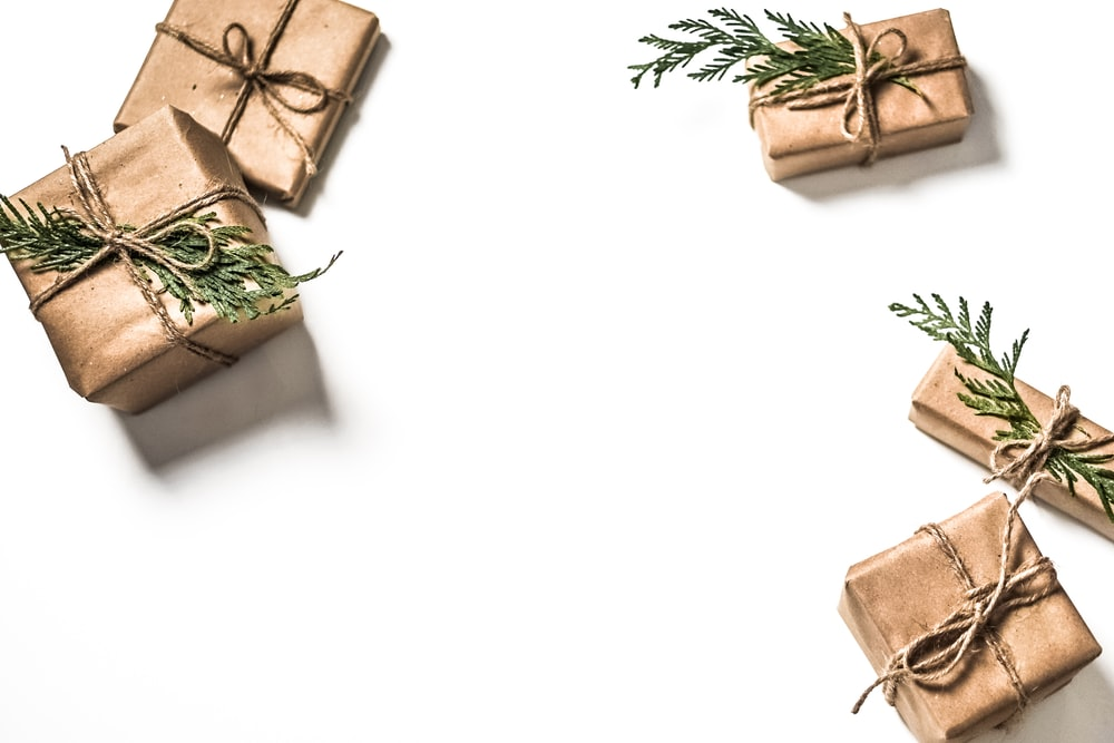 four brown gift boxes on white surface