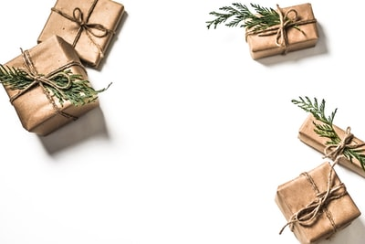 four brown gift boxes on white surface gift zoom background