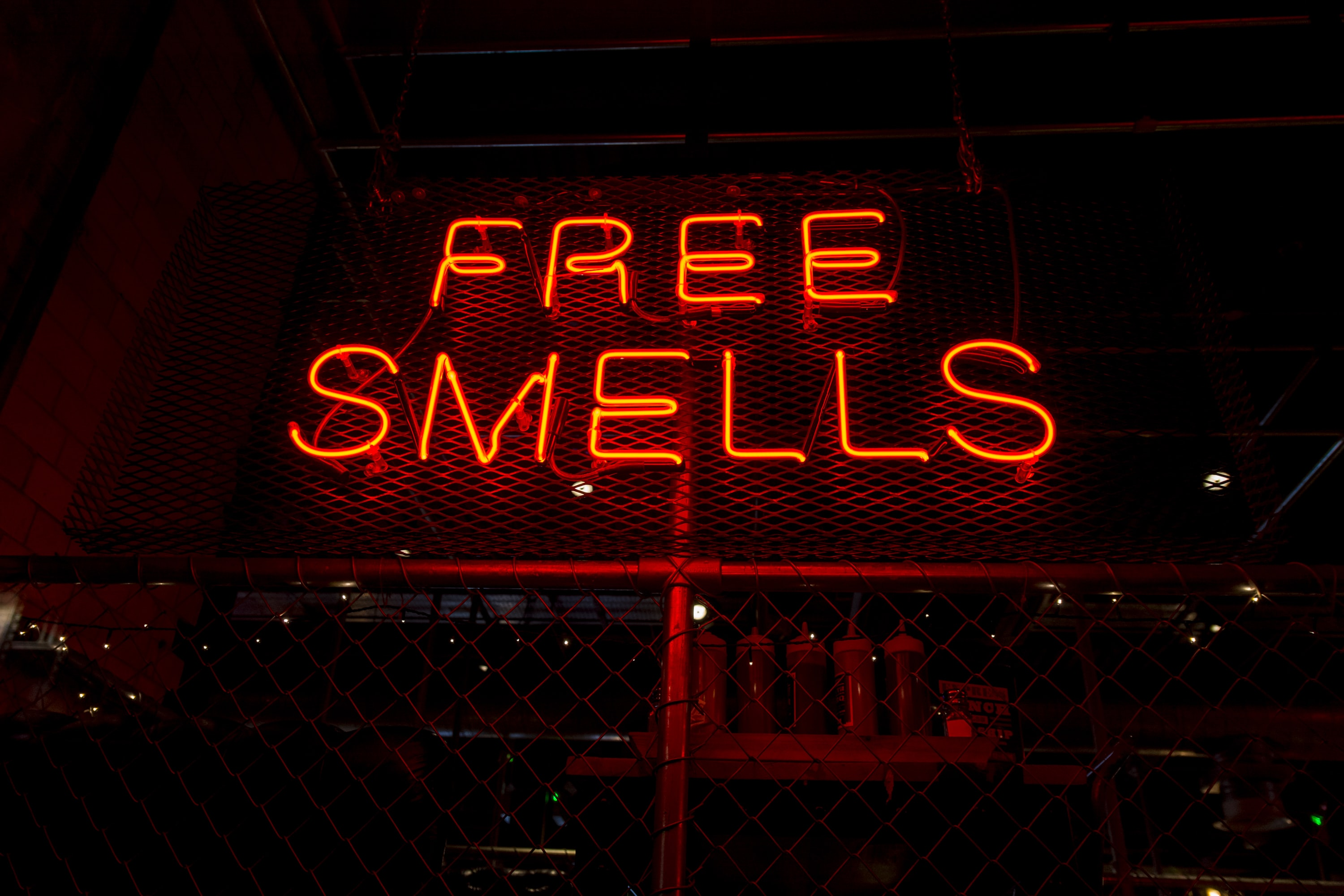 Free Smells neon signage