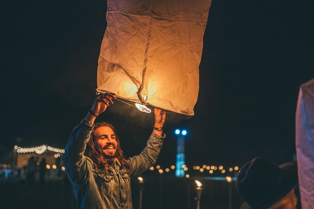 man holding paper lantern
