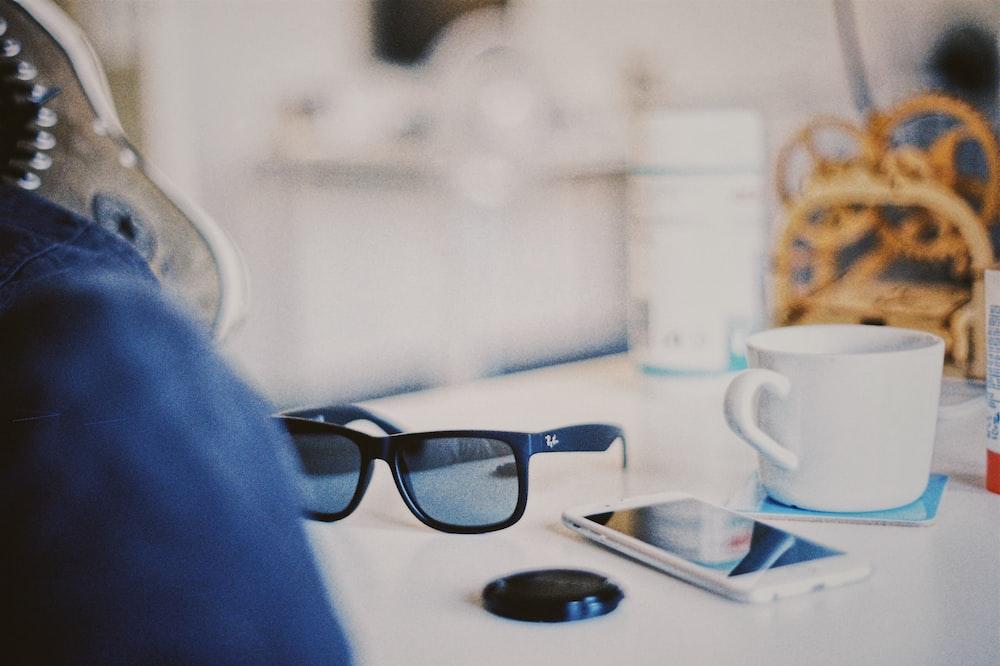 smartphone beside sunglasses