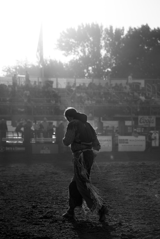 grayscale photo of man wearing cowboy chaps