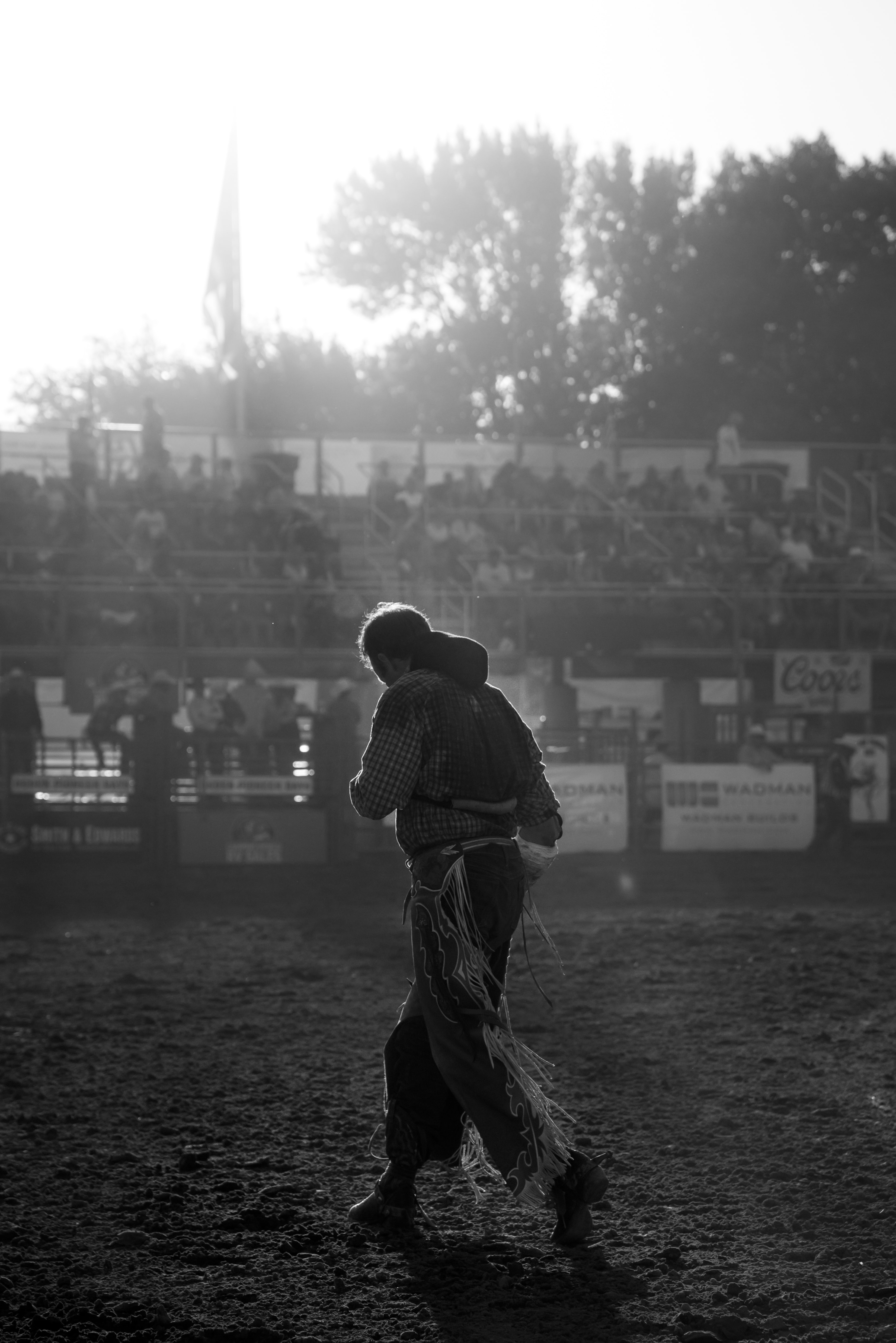 grayscale photo of man wearing cowboy chaps