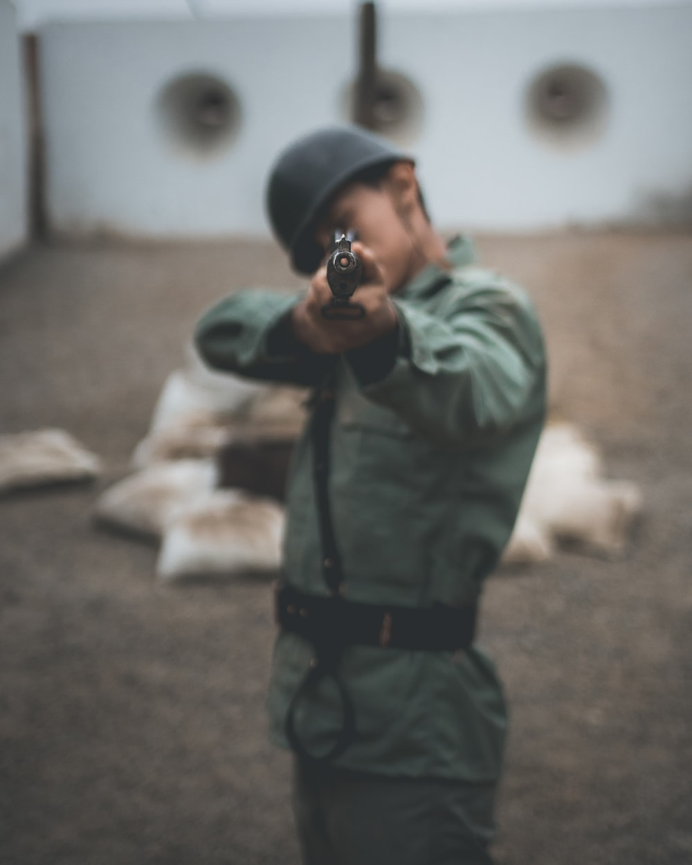 soldier pointing rifle during daytime
