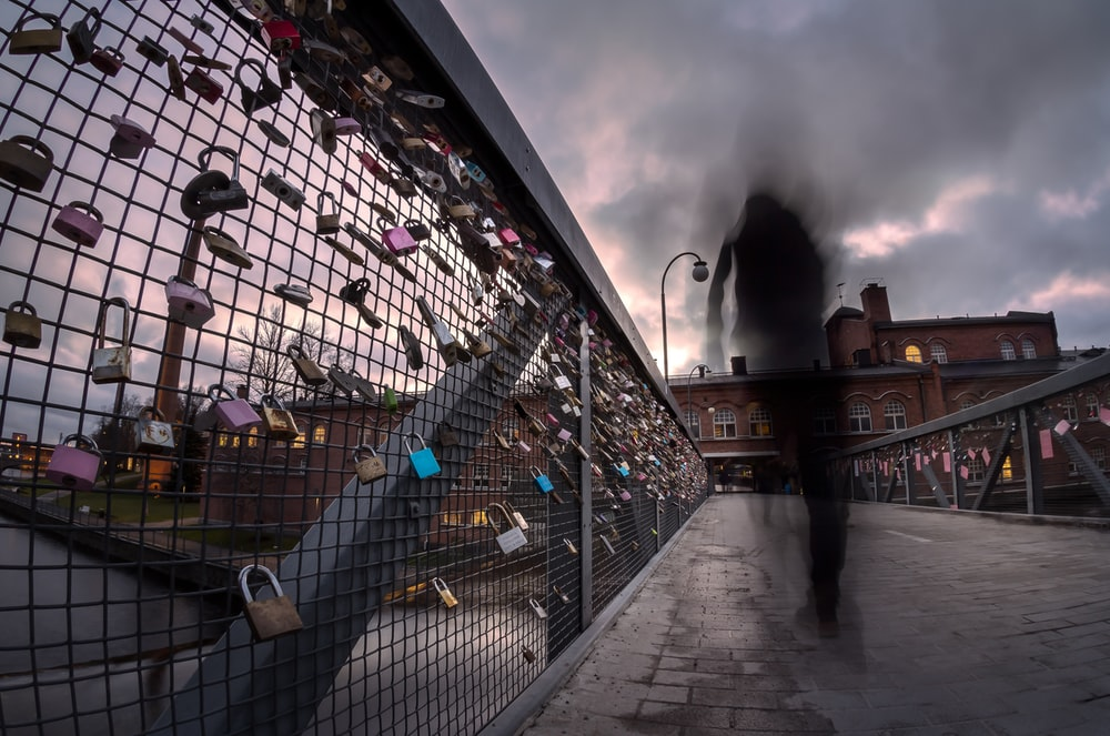 assorted padlock hanging on fence