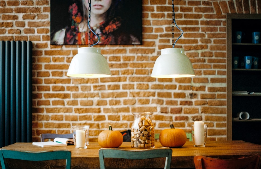 rectangular brown wooden table with two pumpkin on top