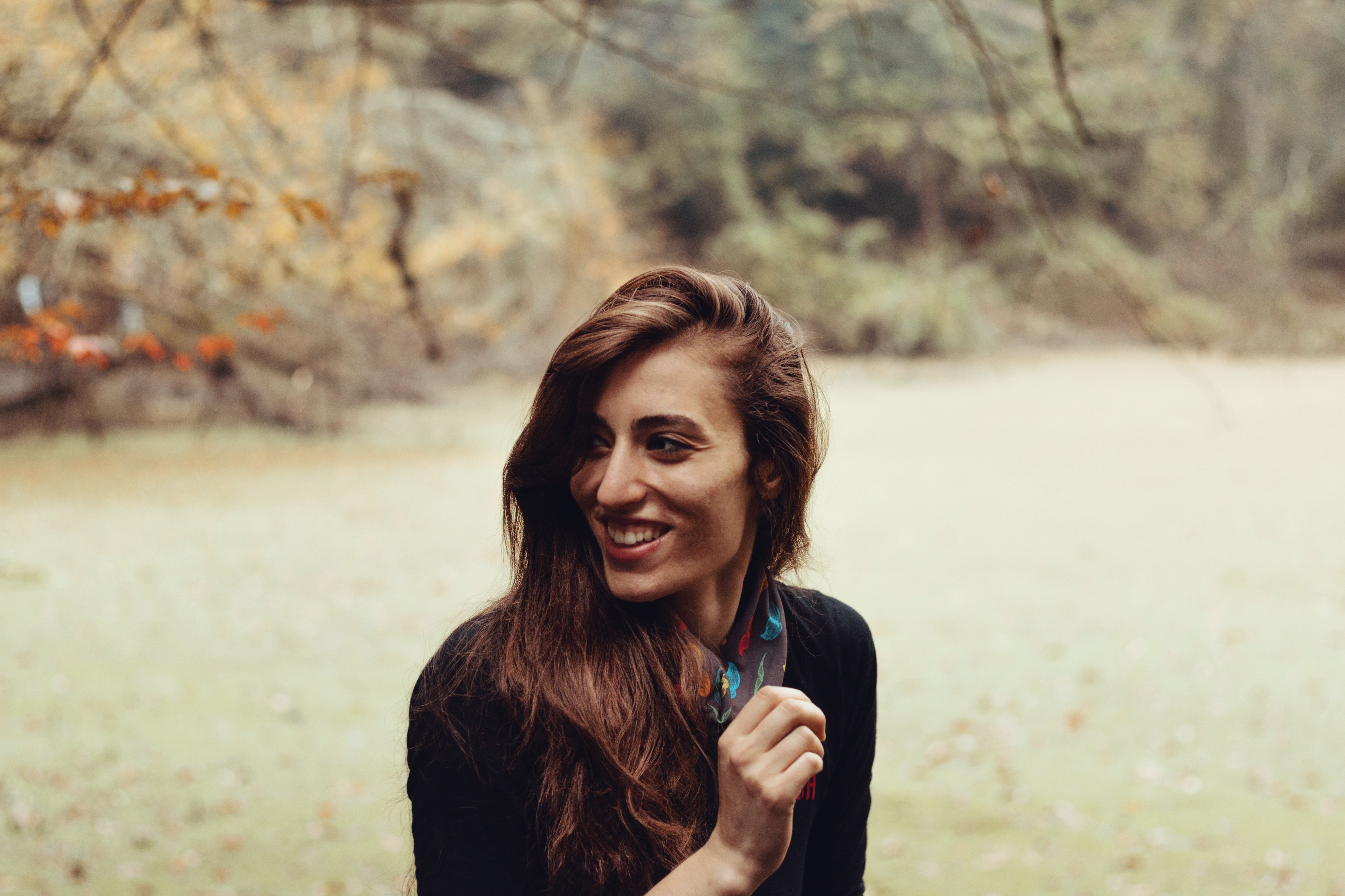 woman smiling outdoor during daytime