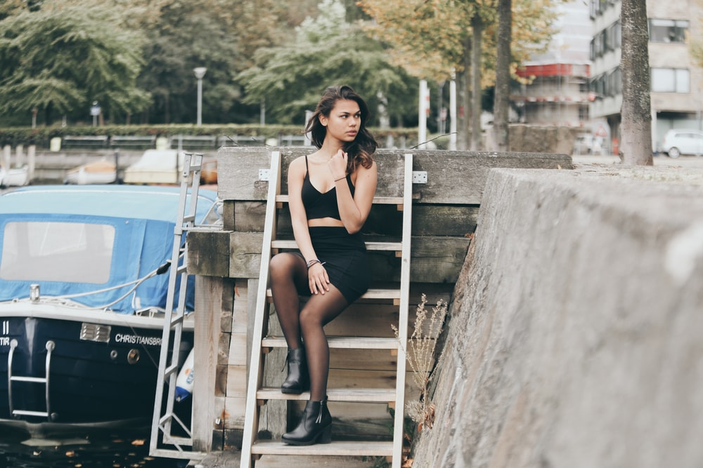 woman sitting on stairs looking somewhere