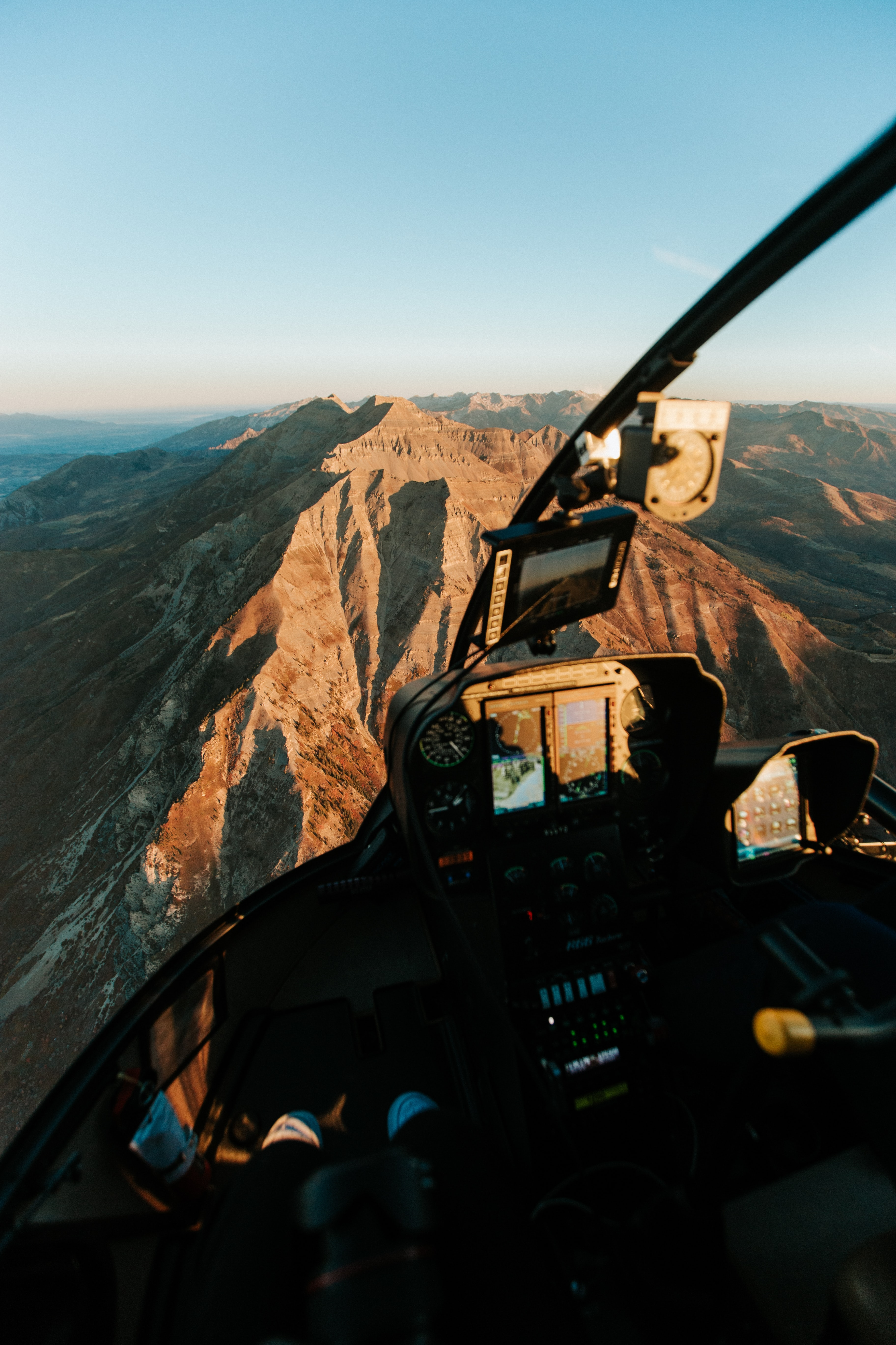 man driving plane on top of mountain